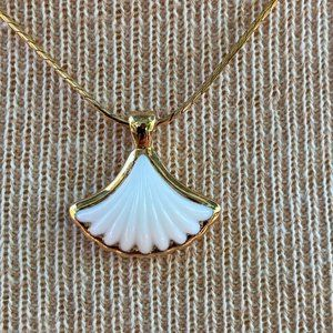 Vintage Monet white shell in gold tone setting and on gold tone chain